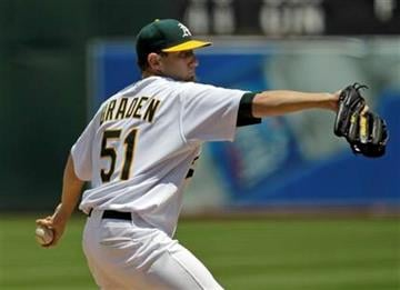 Oakland Athletics starting pitcher Dallas Braden throws to the Tampa Bay Rays during the third inning of a baseball game in Oakland, Calif.  Sunday, May 9, 2010. (AP Photo/Marcio Jose Sanchez) By Marcio Jose Sanchez