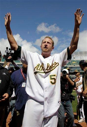 Oakland Athletics starting pitcher Dallas Braden celebrates after throwing a perfect game against the Tampa Bay Rays during a baseball game in Oakland, Calif., Sunday, May 9, 2010. Oakland won 4-0. (AP Photo/Marcio Jose Sanchez) By Marcio Jose Sanchez