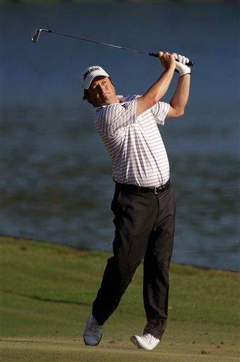 Tim Clark of South Africa hits from the 18th fairway during the final round of The Players Championship golf tournament Sunday, May 9, 2010, in Ponte Vedra Beach, Fla. (AP Photo/Chris O'Meara) By Chris O'Meara