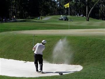Tim Clark of South Africa hits from a sand trap on the 11th hole during the final round of The Players Championship golf tournament Sunday, May 9, 2010, in Ponte Vedra Beach, Fla. (AP Photo/Chris O'Meara) By Chris O'Meara