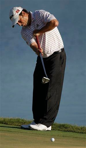 Tim Clark of South Africa putts on the 18th green during the final round of The Players Championship golf tournament Sunday, May 9, 2010, in Ponte Vedra Beach, Fla. Clark finished 16 under par 272. (AP Photo/Chris O'Meara) By Chris O'Meara