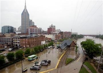 Traffic moves on streets  Monday, May 10, 2010, in Nashville, Tenn., that were flooded one week ago when the Cumberland River, right, flooded after two days of heavy rains. (AP Photo/Mark Humphrey) By Mark Humphrey