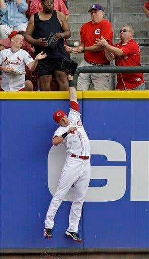 Cincinnati Reds center fielder Drew Stubbs can't reach a two-run home run hit by St. Louis Cardinals' Albert Pujols in the third inning of a baseball game, Friday, May 14, 2010, in Cincinnati. (AP Photo/Al Behrman) By Al Behrman