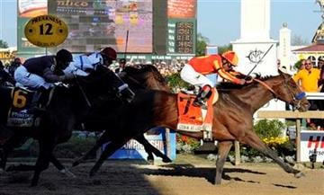 Lookin At Lucky (7), with Martin Garcia aboard, moves over the finish line to win the 135th Preakness horse race at Pimlico Race Course, Saturday, May 15, 2010, in Baltimore. (AP Photo/Mike Stewart) By Mike Stewart