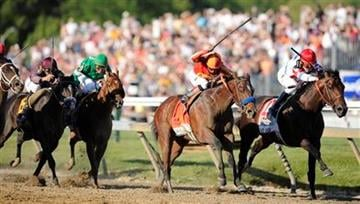 Lookin At Lucky (7), with Martin Garcia aboard, works to overcome First Dude (11), ridden by  Ramon Dominguez, during the 135th Preakness horse race at Pimlico Race Course, Saturday, May 15, 2010, in Baltimore.  (AP Photo/Jim Dietz) By Jim Dietz
