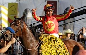 Martin Garcia celebrates aboard Lookin At Lucky after winning the 135th Preakness horse race at Pimlico Race Course, Saturday, May 15, 2010, in Baltimore. (AP Photo/Rob Carr) By Rob Carr