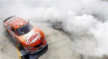 Driver Kyle Busch celebrates after winning the NASCAR Nationwide Series Heluva Good! 200 auto race, Saturday, May 15, 2010, in Dover, Del. (AP Photo/Todd Warshaw, Pool) By Todd Warshaw