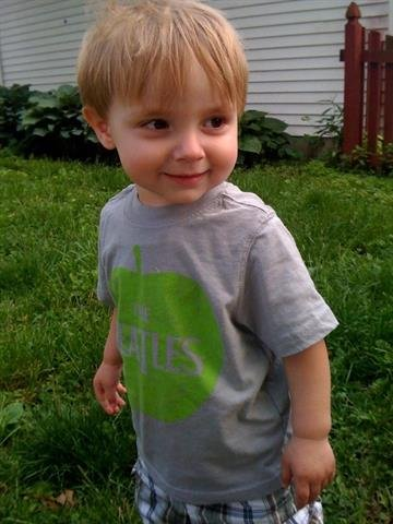 Jude not throwing a tantrum. Having fun, playing in the yard. By Afton Spriggs