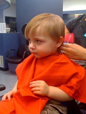 Jude on the verge of a tantrum while getting his hair cut. By Afton Spriggs