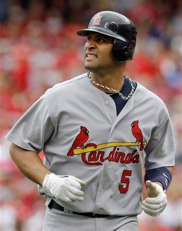St. Louis Cardinals' Albert Pujols looks up at the scoreboard as he runs off the field after grounding out against the Cincinnati Reds in the fourth inning of a baseball game, Sunday, May 16, 2010, in Cincinnati. (AP Photo/Al Behrman) By Al Behrman