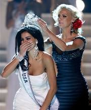 Miss Michigan Rima Fakih, left, reacts as she is crowned Miss USA 2010 by Kristen Dalton, Miss USA 2009, Sunday, May 16, 2010 in Las Vegas. (AP Photo/Isaac Brekken) By Isaac Brekken