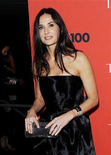 FILE - In this May 4, 2010 file photo, actress Demi Moore attend the TIME 100 gala celebrating the 100 most influential people, at the Time Warner Center in New York. (AP Photo/Evan Agostini, file) By Evan Agostini