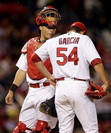 St. Louis Cardinals catcher Yadier Molina, left, talks with starting pitcher Jaime Garcia during the fourth inning of a baseball game against the Florida Marlins on Wednesday, May 19, 2010, in St. Louis. (AP Photo/Jeff Roberson) By Jeff Roberson