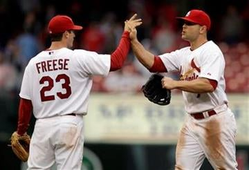 St. Louis Cardinals' David Freese, left, and teammate Matt Holliday celebrate the Cardinals' 4-2 victory over the Florida Marlins in a baseball game, Thursday, May 20, 2010, in St. Louis. (AP Photo/Jeff Roberson) By Jeff Roberson