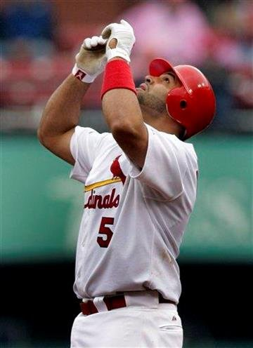 St. Louis Cardinals' Albert Pujols looks skyward after hitting a double during the fifth inning of a baseball game against the Florida Marlins Thursday, May 20, 2010, in St. Louis. (AP Photo/Jeff Roberson) By Jeff Roberson