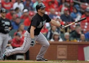Florida Marlins' Dan Uggla hits a sacrifice fly scoring teammate Gaby Sanchez during the first inning of a baseball game against the St. Louis Cardinals, Thursday, May 20, 2010, in St. Louis. (AP Photo/Jeff Roberson) By Jeff Roberson