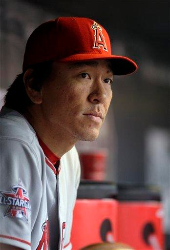 Los Angeles Angels' Hideki Matsui sits in the dugout during the first inning of a baseball game against the St. Louis Cardinals Friday, May 21, 2010, in St. Louis. (AP Photo/Jeff Roberson) By Jeff Roberson