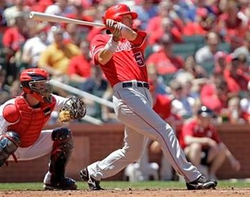 Los Angeles Angels designated hitter Hideki Matsui (55) connects for a two-RBI single as St. Louis Cardinals catcher Jason LaRue watches during the third inning of a baseball game, Saturday, May 22, 2010 in St. Louis.(AP Photo/Tom Gannam) By Tom Gannam