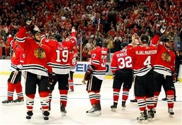 Chicago Blackhawks players salute their fans after their 4-2 win over the San Jose Sharks in Game 4 of the NHL Western Conference finals Sunday, May 23, 2010 in Chicago. The Blackhawks swept the series 4-0. (AP Photo/Nam Y. Huh) By Nam Y. Huh
