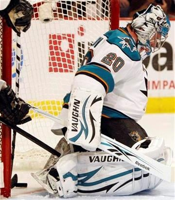 San Jose Sharks goalie Evgeni Nabokov can't save a shot by Chicago Blackhawks' Brent Seabrook during second period hockey action in Game 4 of the NHL Western Conference finals, Sunday, May 23, 2010, in Chicago.(AP Photo/Nam Y. Huh) By Nam Y. Huh