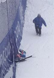 Lindsey Vonn, from the United States, lies in the fence after crashing during first run of the women's giant slalom in Whistler, British Columbia, Wednesday, Feb. 24, 2010. (AP Photo/Charlie Riedel) By Charlie Riedel