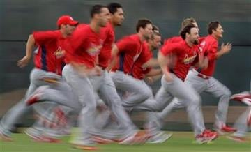 Members of the St. Louis Cardinals run sprints during spring training baseball on Tuesday, Feb. 23, 2010, in Jupiter, Fla. (AP Photo/Jeff Roberson) By Jeff Roberson