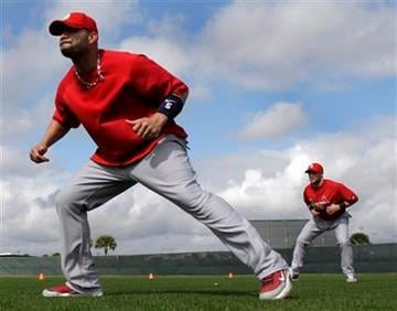 St. Louis Cardinals first baseman Albert Pujols, left, and second baseman Skip Schumaker warm up at the start of practice during spring training baseball on Tuesday, Feb. 23, 2010, in Jupiter, Fla. (AP Photo/Jeff Roberson) By Jeff Roberson