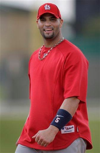 St. Louis Cardinals first baseman Albert Pujols smiles as he walks off a field during spring training baseball on Tuesday, Feb. 23, 2010, in Jupiter, Fla. (AP Photo/Jeff Roberson) By Jeff Roberson