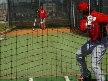 Cardinals center fielder Colby Rasmus hits off the pitching machine during workouts Friday morning. By KMOV Web Producer