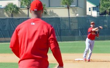 Cardinals first baseman Albert Pujols waits on a ball thrown by second baseman Skip Schumaker. By Lakisha Jackson