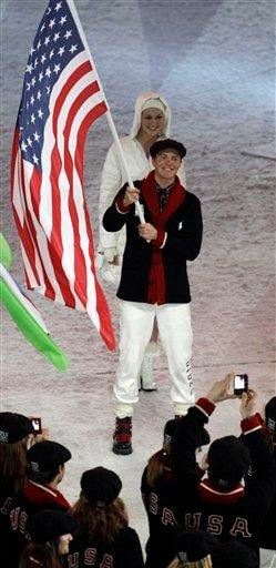 USA's Bill Demong carries the flag during the closing ceremony for the Vancouver 2010 Olympics in Vancouver, British Columbia, Sunday, Feb. 28, 2010. (AP Photo/Charlie Riedel) By Charlie Riedel