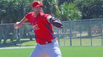 2009 Cy Young Award finalist Adam Wainwright throws a pitch during live batting practice Monday afternoon. By Lakisha Jackson