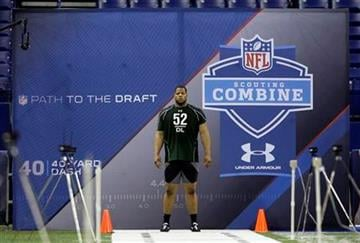 Nebraska's Ndamukong Suh prepares to run the 40-yard dash at the NFL football scouting combine in Indianapolis, Monday, March 1, 2010. (AP Photo/Michael Conroy) By Michael Conroy