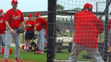 Cardinals third base coach Jose Oquendo hitting grounders during infield drills Tuesday. By Lakisha Jackson