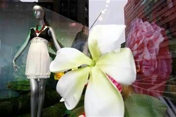 """Clothes inspired by the new movie """"Alice in Wonderland"""" are displayed in the windows of Bloomingdales in New York, Wednesday, March 3, 2010.  (AP Photo/Seth Wenig) By Seth Wenig"""