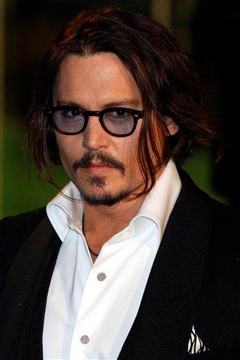 US actor Johnny Depp arrives for the Royal World Premiere of the movie Alice in Wonderland in Leicester Square, London, Thursday, Feb. 25, 2010. (AP Photo/Kirsty Wigglesworth) By Kirsty Wigglesworth
