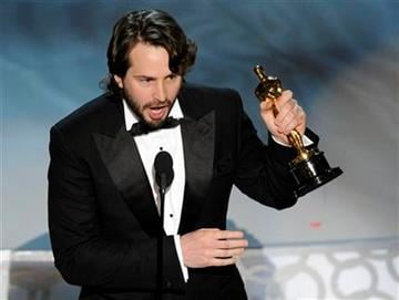 "Mark Boal accepts the Oscar for best original screenplay for ""The Hurt Locker"" at the 82nd Academy Awards Sunday, March 7, 2010, in the Hollywood section of Los Angeles. (AP Photo/Mark J. Terrill) By Mark J. Terrill"