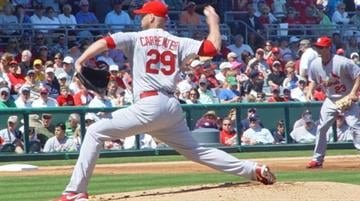 Cardinals pitcher Chris Carpenter throws a pitch during Monday's game against the Boston Redsox. By Lakisha Jackson