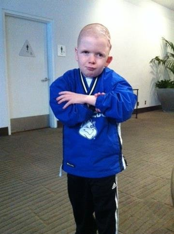 Joshua Brown showing off his impression of SLU Men's Basketball coach Jim Crews. By Sarah Heath