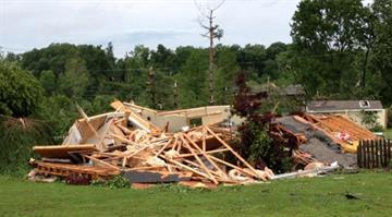 EF2 tornado damage to a detached garage on Clover Valley Lane. By Brendan Marks