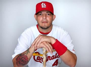 JUPITER, FL - FEBRUARY 19:  Yadier Molina #4 of the St. Louis Cardinals poses during photo day at Roger Dean Stadium on February 19, 2013 in Jupiter, Florida.  (Photo by Mike Ehrmann/Getty Images) By Mike Ehrmann