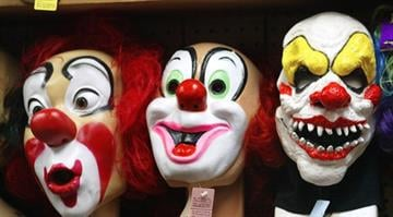 Clown masks are displayed at the Fantasy Costumes HDQ. store October 17, 2003 in Chicago, Illinois. By Tim Boyle