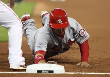MIAMI, FL - JUNE 15:  Jon Jay #19 of the St. Louis Cardinals slides safely into first base against the Miami Marlins during the first inning at Marlins Park on June 15, 2013 in Miami, Florida.  (Photo by Marc Serota/Getty Images) By Marc Serota