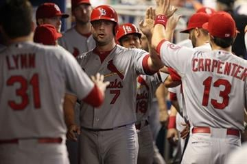 MIAMI, FL - JUNE 15:  Matt Holiday #7 of the St. Louis Cardinals celebrates with teamates against the Miami Marlins during the first inning at Marlins Park on June 15, 2013 in Miami, Florida.  (Photo by Marc Serota/Getty Images) By Marc Serota