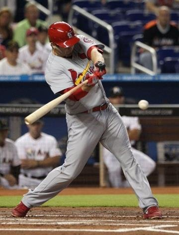 MIAMI, FL - JUNE 15: David Freese #23 of the St. Louis Cardinals hits an RBI single against the Miami Marlins during the first inning at Marlins Park on June 15, 2013 in Miami, Florida.  (Photo by Marc Serota/Getty Images) By Marc Serota