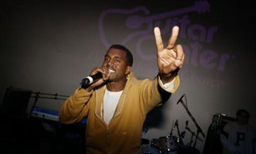 NEW YORK - DECEMBER 5: Musician Kanye West performs at the Fader 20 Pop Life Party at Diane Von Furstenberg NYC Studios December 5, 2003 in New York City. (Photo by Mark Mainz/Getty Images) By Mark Mainz