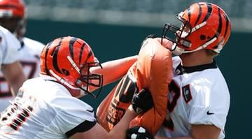 Offensive linemen Tanner Hawkinson #72 and T.J. Johnson #60 of the Cincinnati Bengals work out during a rookie camp at Paul Brown Stadium on May 12, 2013 in Cincinnati, Ohio. (Photo by Joe Robbins/Getty Images) By Joe Robbins