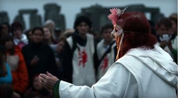 Celebrants take part in a summer solstice dawn ceremony, as druids, pagans and revelers wait for the midsummer sun to rise at the megalithic monument of Stonehenge, June 21, 2012 near Amesbury, England. / Matt Cardy/Getty Images By Brendan Marks