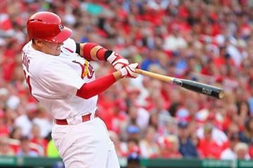 ST. LOUIS, MO - JUNE 21:  Allen Craig #21 of the St. Louis Cardinals hits an RBI double against the Texas Rangers in the first inning at Busch Stadium on June 21, 2013 in St. Louis, Missouri.  (Photo by Dilip Vishwanat/Getty Images) By Dilip Vishwanat