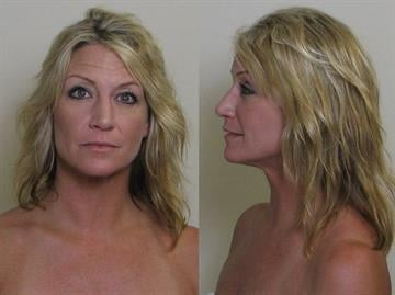 Alicia Binford, 43, from O'Fallon, Missouri has been charged with public indecency after she allegedly exposed her breasts on an Alton, Illinois golf course. By Eric Lorenz